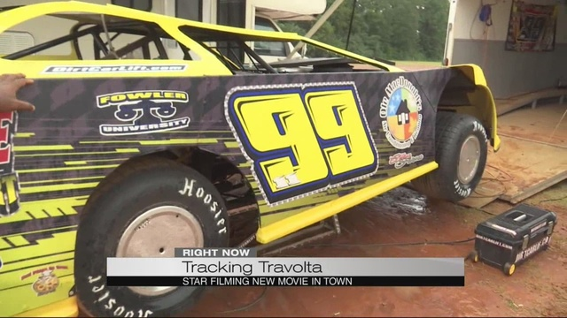 Dirt track drivers race alongside Travolta in Trading Paint